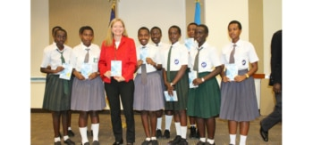 Ambassador Erica Barks-Ruggles with students launching the 5th Annual Everybody Reads Rwanda Campaign