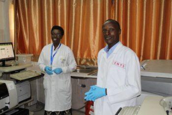 NCBT staffers Jeannettemu Muhoracyeye and Sadiki Wilson at work at the NCBT facility.